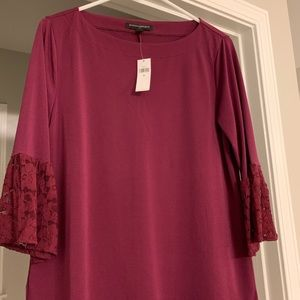 Burgundy blouse worn lace on sleeve